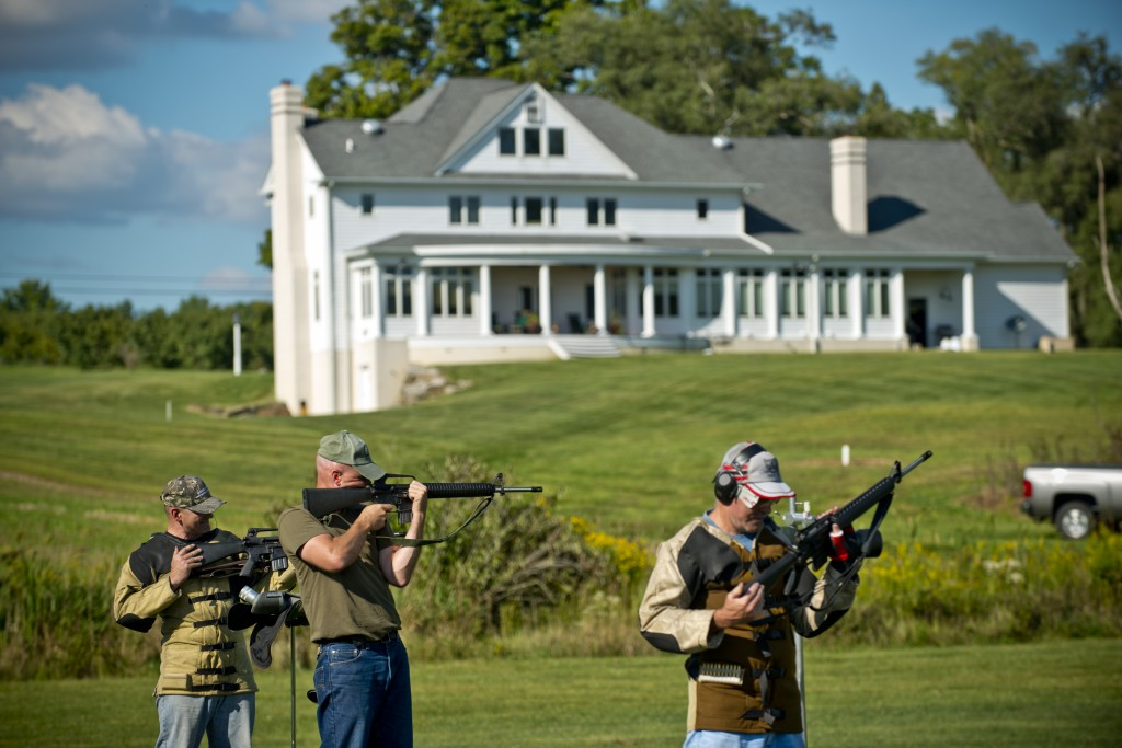 Lt. Col. John Cletus Paumier (center) takes aim with his AR-15 Rifle among friends on his own private 600-yard rifle range built in his back yard which spans eight acres of land in Salem, Ohio. Paumier not only designed the range, but he also designed the 4,000-square-foot home on the hill behind him. Paumier is an orthopedic surgeon, officer in charge of the Army Reserve Marksmanship Program and command surgeon for the 416th Theater Engineer Command, headquartered in Darien, Illinois. (U.S. Army photo by Sgt. 1st Class Michel Sauret)