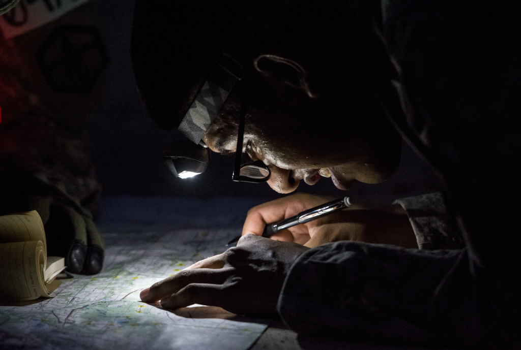 A U.S. Army Reserve combat engineer from the 374th Engineer Company (Sapper), of Concord, Calif., plots points on a map as the night sets in during a team-based land navigation course as part of the 2015 Sapper Stakes competition at Fort Chaffee, Ark., Aug. 30. The competition is designed to build teamwork, enhance combat engineering skills and promote leadership among the units.