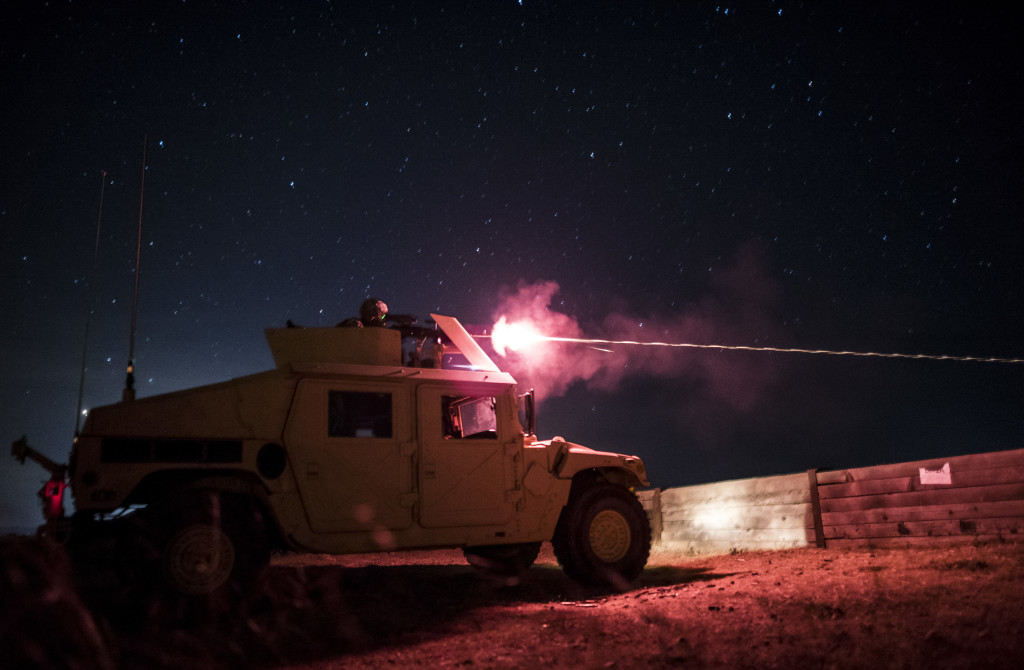 A U.S. Army Reserve military police gunner from the 341st MP Company, of Mountain View, California, shoots at target with an M240B machine gun during a mounted crew-served weapon night fire qualification table at Fort Hunter-Liggett, California, May 3. The 341st MP Co. is one of the first units in the Army Reserve conducting a complete 6-table crew-serve weapon qualification, which includes firing the M2, M249 and M240B machine guns both during the day and night. (U.S. Army photo by Master Sgt. Michel Sauret)