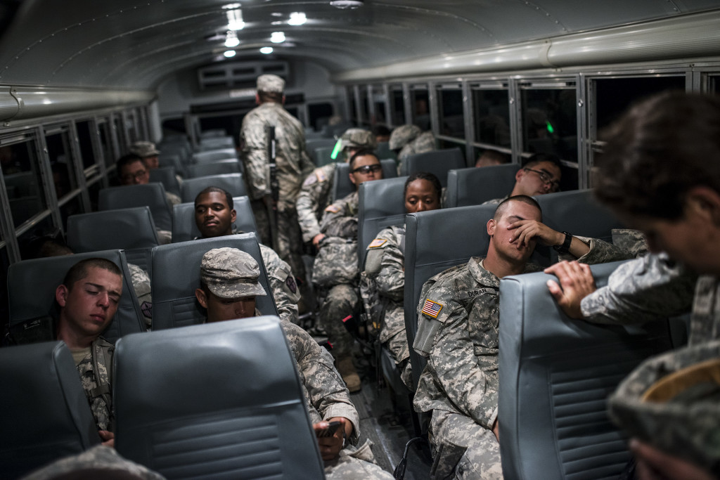 "U.S. Army Reserve Combat Engineer Soldiers from the 374th Engineer Company (Sapper), headquartered in Concord, Calif., take a break on a bus after completing a night land navigation course through the hills and mountains of Camp San Luis Obispo Military Installation, Calif., July 15, during a two-week field exercise known as a Sapper Leader Course Prerequisite Training. The land navigation course began after dark and most Soldiers didn't finish until after midnight after trecking for miles through the steep California hills. The unit is grading its Soldiers on each event to determine which ones will earn a spot on a ""merit list"" to attend the Sapper Leader Course at Fort Leonard Wood, Mo."