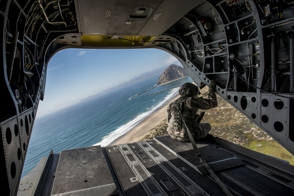 A California National Guard flight engineer looks out the back of a CH-47 Chinook during a rehearsal flyover for the 374th Engineer Company (Sapper) July 15 at Camp San Luis Obispo Military Installation, Calif. (U.S. Army photo by Master Sgt. Michel Sauret)