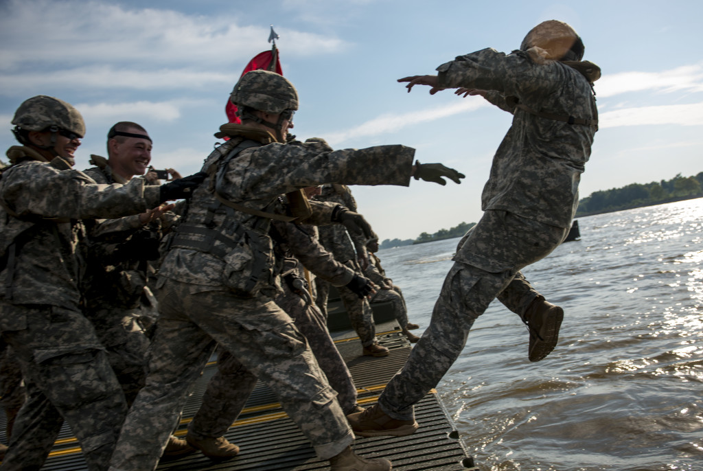 "Army Reserve Soldiers from the 310th Engineer Company (Multi-Role Bridge), from Fort A.P. Hill, Va., ""baptize"" 1st Lt. Shane Yingling, executive officer, into the Arkansas River during Operation River Assault 2015, a bridging training exercise involving Army Engineers and other support elements to create a modular floating bridge at Fort Chaffee, Ark., Aug. 4, using improved ribbon bridge bays. The entire training exercise lasted from July 28 to Aug. 4, 2015, involving one brigade headquarters, two battalions and 17 other units, to include bridging, sapper, mobility, construction and aviation companies. (U.S. Army photo by Master Sgt. Michel Sauret)"