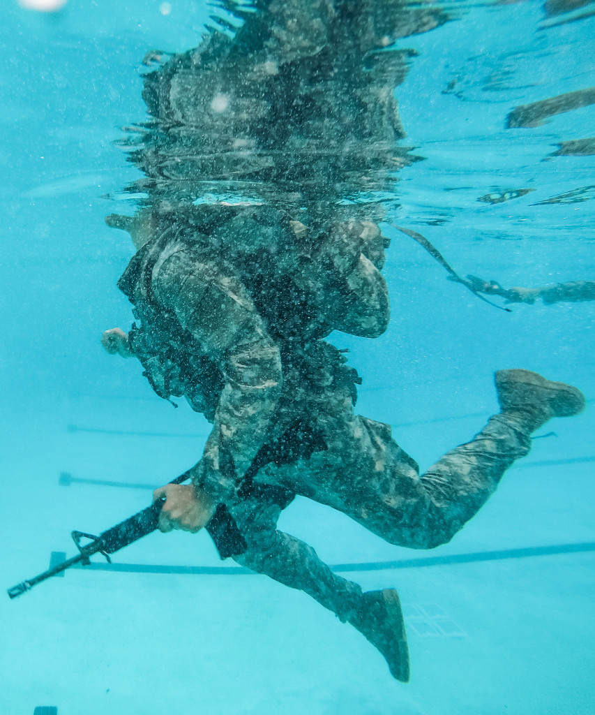 "A U.S. Army Reserve combat engineer Soldier from the 374th Engineer Company (Sapper), headquartered in Concord, Calif., swims 25 meters with a ruck sack and a dummy rifle for a Combat Water Survival Training at Fort Hunter Liggett, Calif., July 17, during a two-week field exercise known as a Sapper Leader Course Prerequisite Training at Camp San Luis Obispo Military Installation, Calif. The unit is grading its Soldiers on various events to determine which ones will earn a spot on a ""merit list"" to attend the Sapper Leader Course at Fort Leonard Wood, Mo."