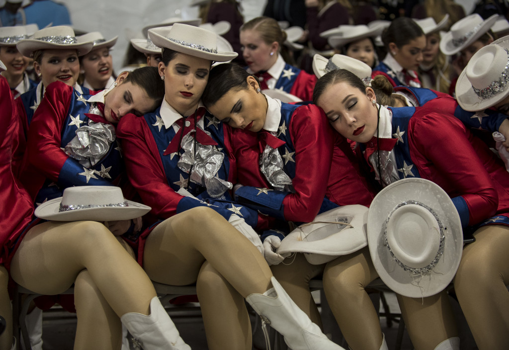 Raiders dancers from West Monroe High School, Louisiana, take a nap before the start of the 58th Presidential Inauguration Parade in Washington, D.C., on Jan. 20. The parade route stretched approximately 1.5 miles along Pennsylvania Avenue from the U.S. Capitol to the White House. (U.S. Army Reserve photo by Master Sgt. Michel Sauret)