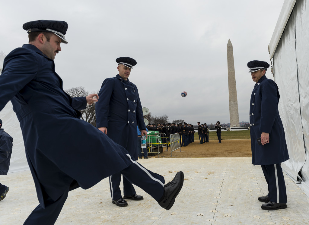 U.S. Air Force band members play hacky sack before taking part in the 58th Presidential Inauguration Parade in Washington, D.C., on Jan. 20. The parade route stretched approximately 1.5 miles along Pennsylvania Avenue from the U.S. Capitol to the White House. (U.S. Army Reserve photo by Master Sgt. Michel Sauret)