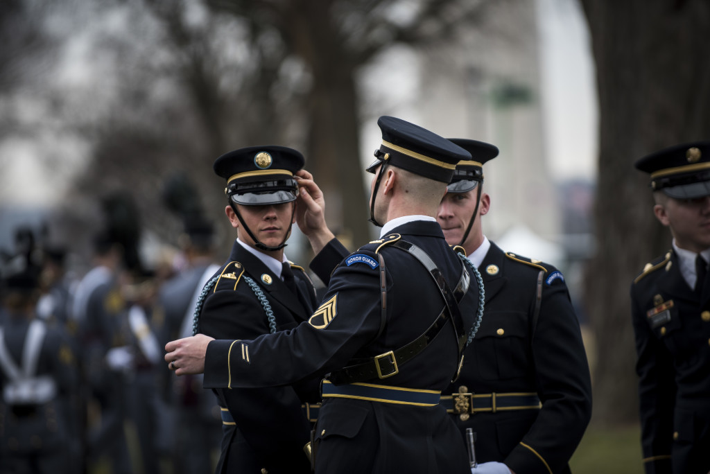 U.S. Army Soldiers from the 3rd Infantry Regiment (The Old Guard) make final adjustments to their uniforms before the start of the 58th Presidential Inauguration Parade in Washington, D.C., on Jan. 20. The parade route stretched approximately 1.5 miles along Pennsylvania Avenue from the U.S. Capitol to the White House. (U.S. Army Reserve photo by Master Sgt. Michel Sauret)