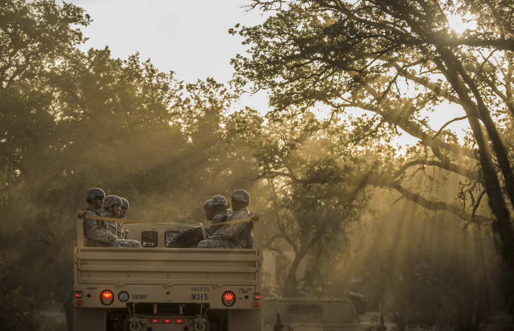 A group of U.S. Army Reserve Soldiers ride on the back of a troop-carrier truck after eating breakfast to go training on Fort Hunter-Liggett, California, May 3. Approximately 80 units from across the U.S. Army Reserve, Army National Guard and active Army are participating in the 84th Training Command's second Warrior Exercise this year, WAREX 91-16-02, hosted by the 91st Training Division at Fort Hunter-Liggett, California. (U.S. Army photo by Master Sgt. Michel Sauret)