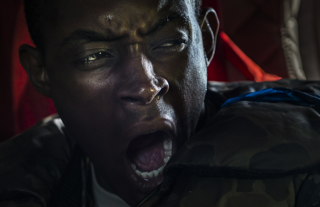 An Army Reserve Soldier from the 364th Engineer Company (Sapper), headquartered in Salt Lake City, yawns after returning to a Chinook and having jumped into the Arkansas River during a training exercise known as a helocast at Fort Chaffee, Ark., Aug. 1, as part of Operation River Assault. The entire River Assault training exercise lasted from July 28 to Aug. 4, 2015, involving one brigade headquarters, two battalions and 17 other units, to include bridging, sapper, mobility, construction and aviation companies. (U.S. Army photo by Master Sgt. Michel Sauret)