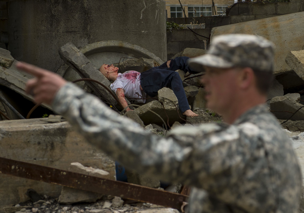 A mannequin lies in the rubble of a training site during Guardian Response 17 at the Muscatatuck Urban Training Center, Indiana, April 27, 2017. Guardian Response, as part of Vibrant Response, is a multi-component training exercise run by the U.S. Army Reserve designed to validate nearly 4,000 service members in Defense Support of Civil Authorities (DSCA) in the event of a Chemical, Biological, Radiological and Nuclear (CBRN) catastrophe. This year's exercise simulated an improvised nuclear device explosion with a source region electromagnetic pulse (SREMP) out to more than 4 miles. The 84th Training Command is the hosting organization for this exercise, with the training operations run by the 78th Training Division, headquartered in Fort Dix, New Jersey. (U.S. Army Reserve photo by Master Sgt. Michel Sauret)