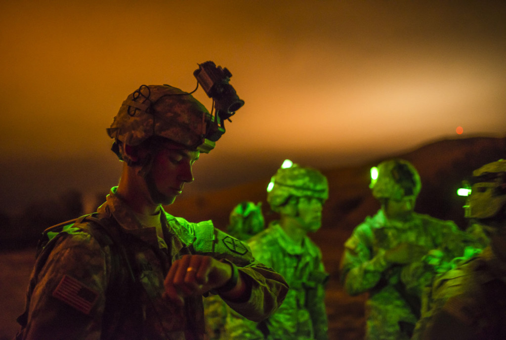 "A U.S. Army Reserve combat engineer Soldier from the 374th Engineer Company (Sapper), headquartered in Concord, Calif., checks his watch before a night land navigation course through the hills of Camp San Luis Obispo Military Installation, Calif., July 15, during a two-week field exercise known as a Sapper Leader Course Prerequisite Training. The land navigation course began after dark and most Soldiers didn't finish until after midnight after trekking for miles through the steep hills. The unit is grading its Soldiers on each event to determine which top ones will earn a spot on a ""merit list"" to attend the Sapper Leader Course at Fort Leonard Wood, Mo. (U.S. Army photo by Master Sgt. Michel Sauret)"